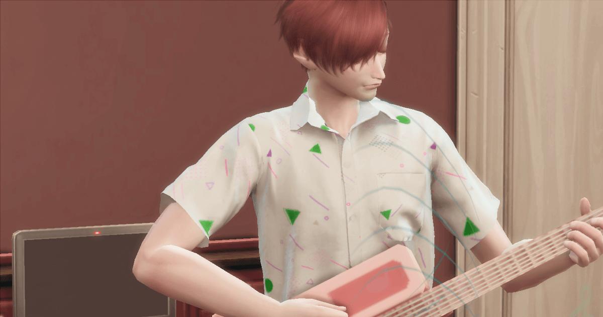 ギターを弾いている八神朝陽